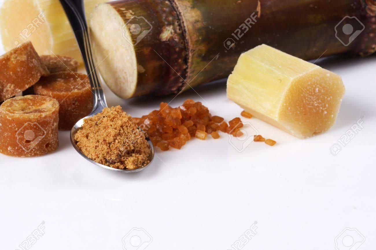 Various kinds of sugar, brown sugar, reed sugar, sugar cane and cane. Stock Photo - 18518518