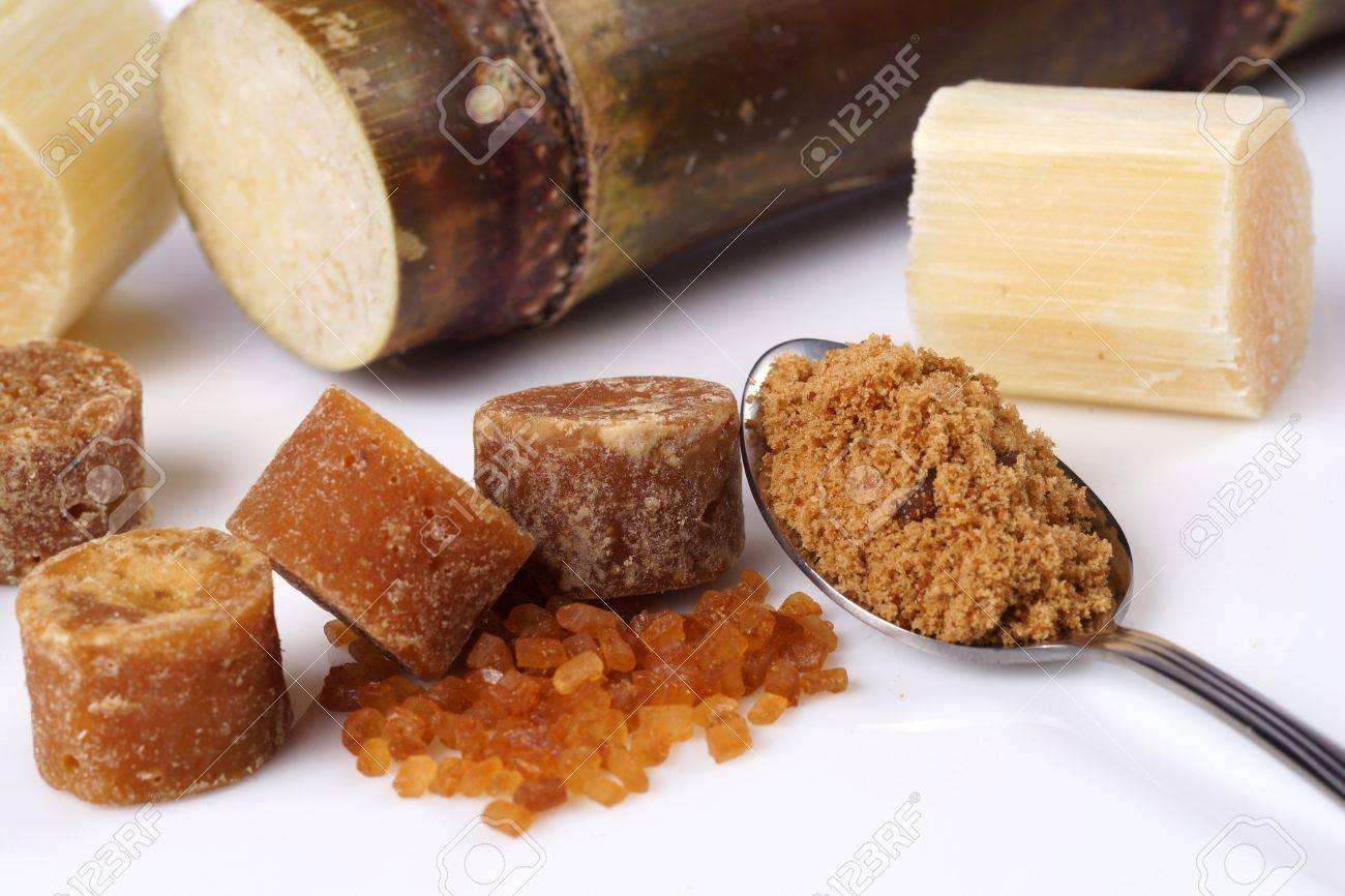 Various kinds of sugar, brown sugar, reed sugar, sugar cane and cane. Stock Photo - 18518585