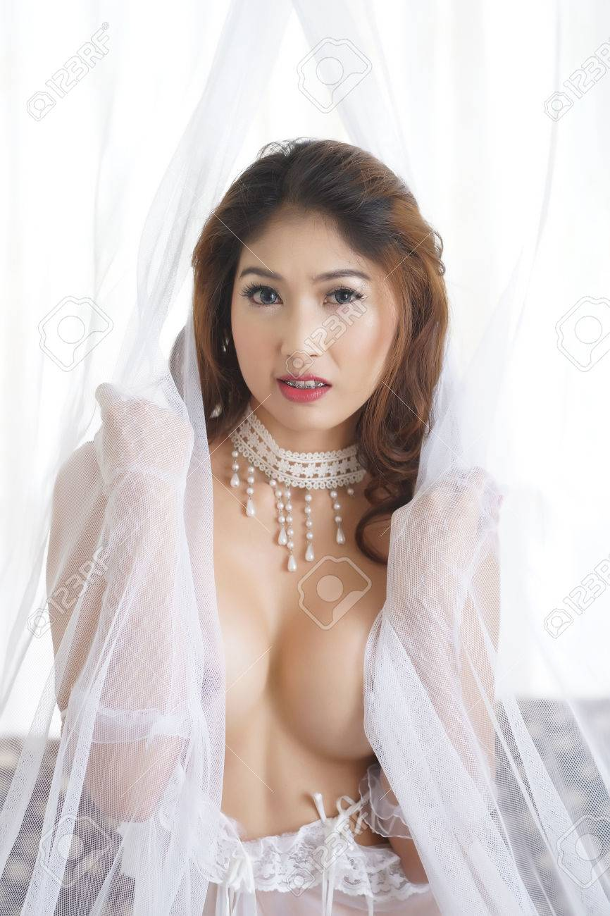 Beautiful Asian Woman In Sexy Lingerie In Bedroom Stock Photo 24311956