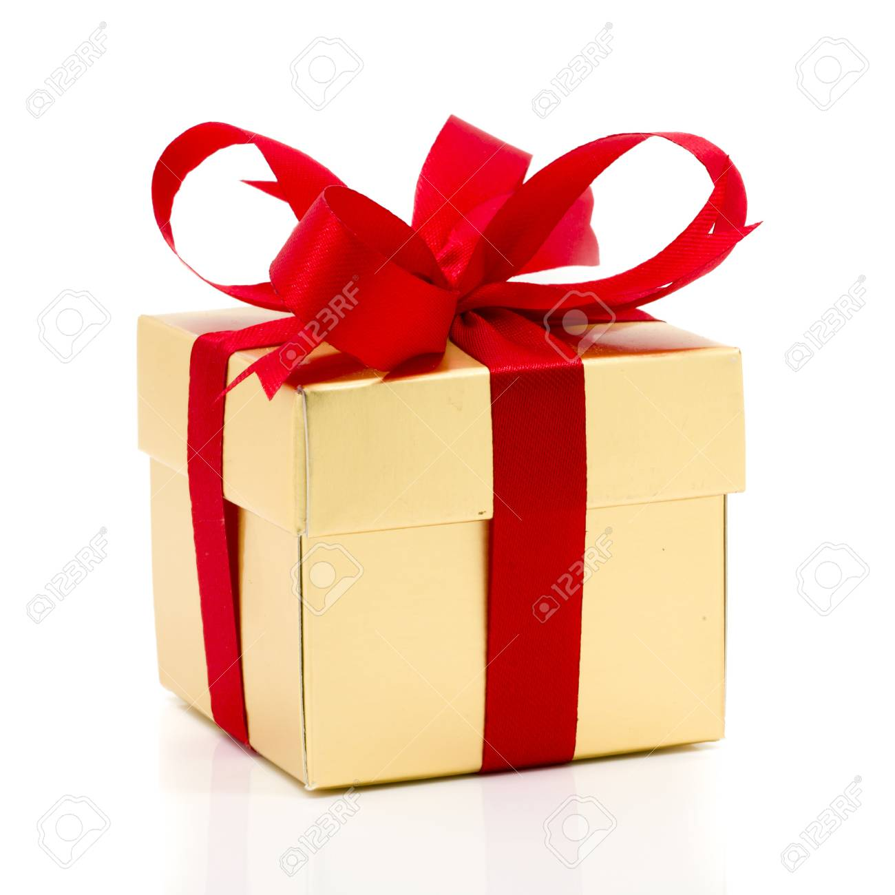 Beautiful Gold Present Box With Red Bow And Ribbons On White