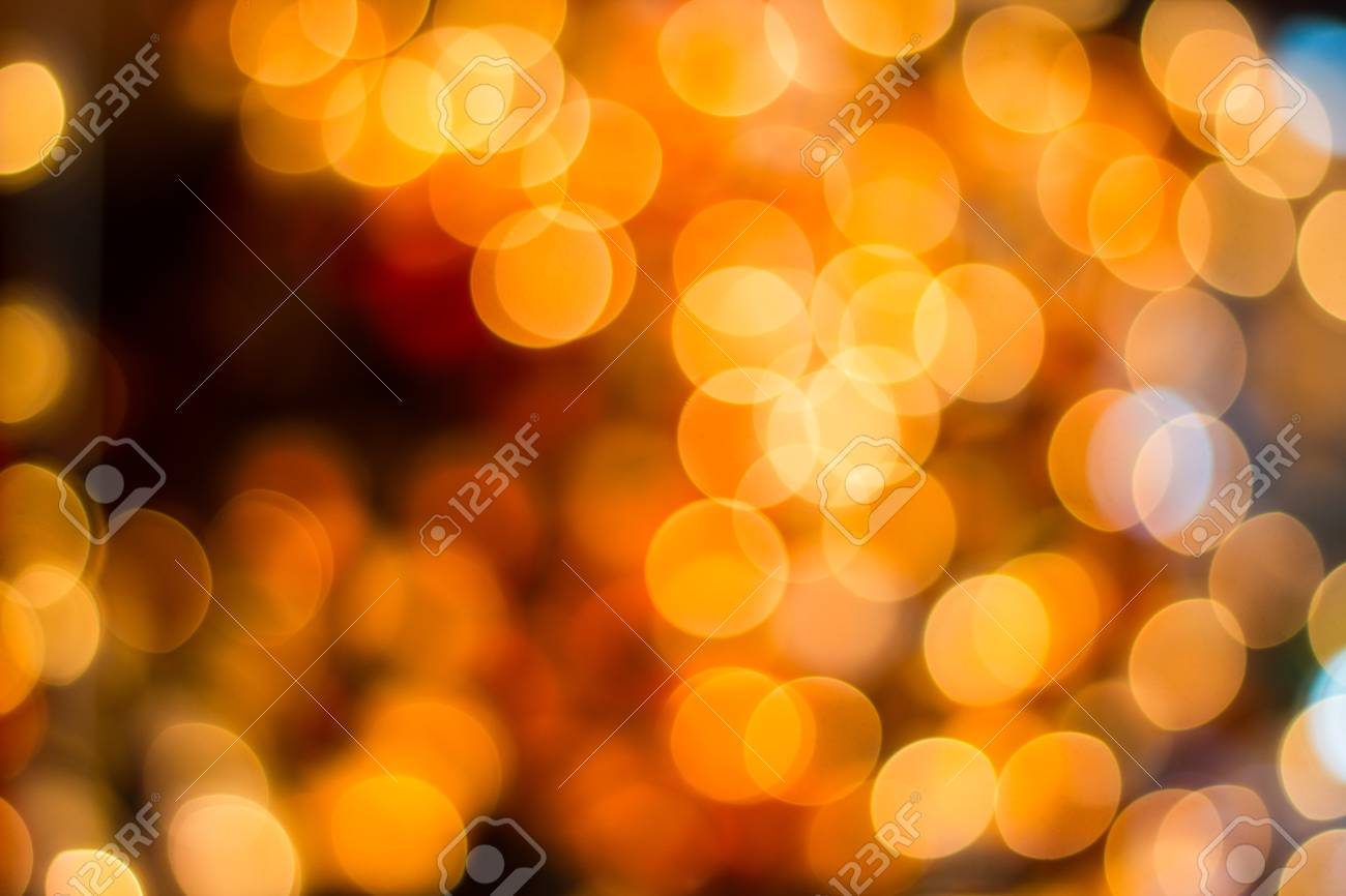 Blurred bokeh decorative outdoor string lights hanging on tree blurred bokeh decorative outdoor string lights hanging on tree in the garden at night time aloadofball Choice Image