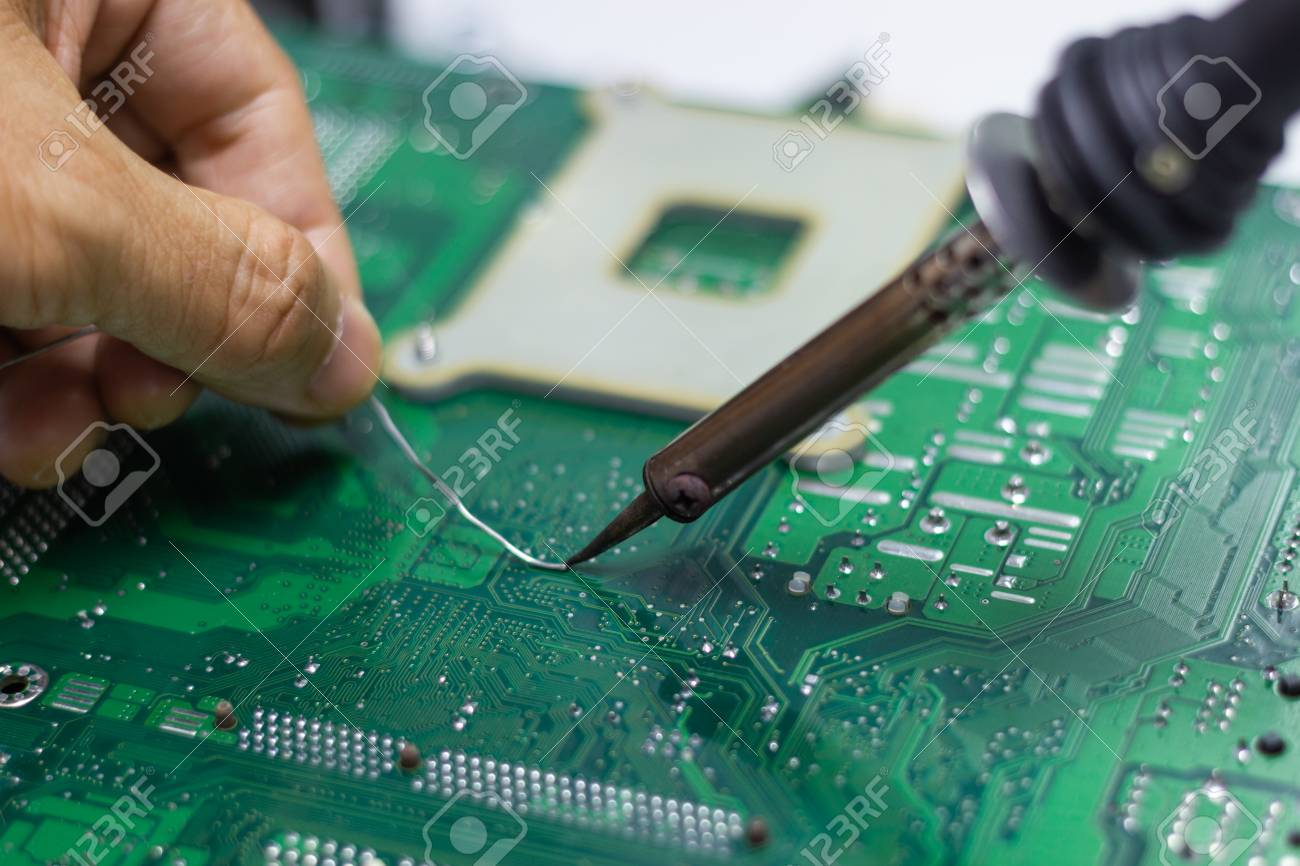 Soldering Iron Is Hand Tool Repairing Electronic Of The Computers Circuit Board By Irons