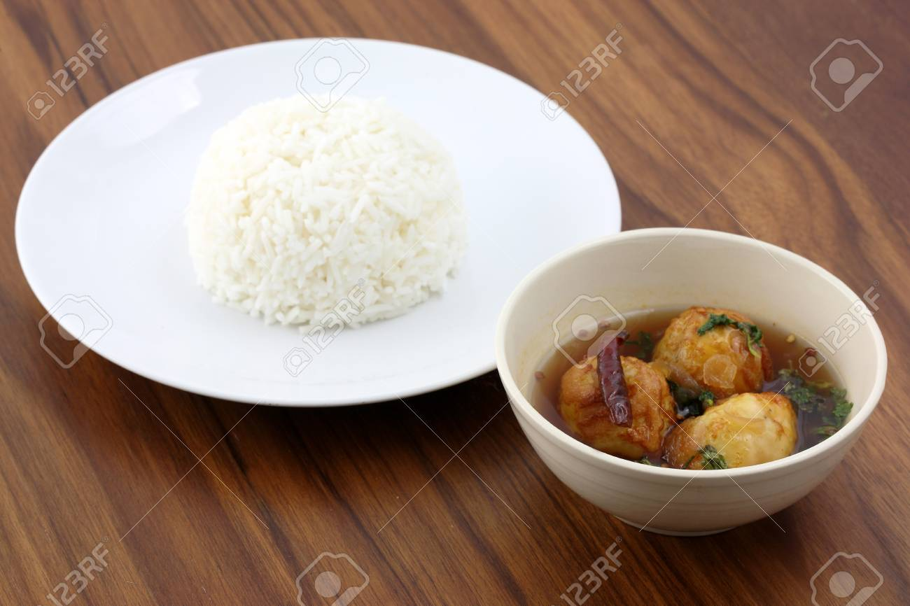 Thai food , boiled egg fired with sweet sauce in wood background Stock Photo - 10355434
