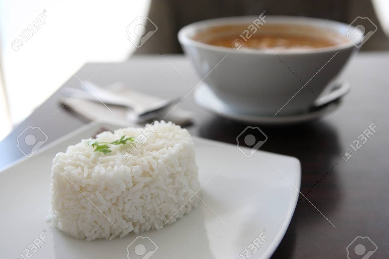 Thai traditional spicy prawn soup , Tom yum kung with rice Stock Photo - 11195539