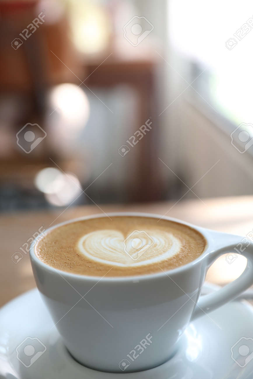 cappuccino or Latte art coffee made from milk on the wood table in coffee shop - 133949280