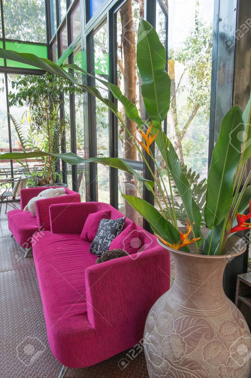 Beautiful Living Room With Pink Sofa Abd Big Vase