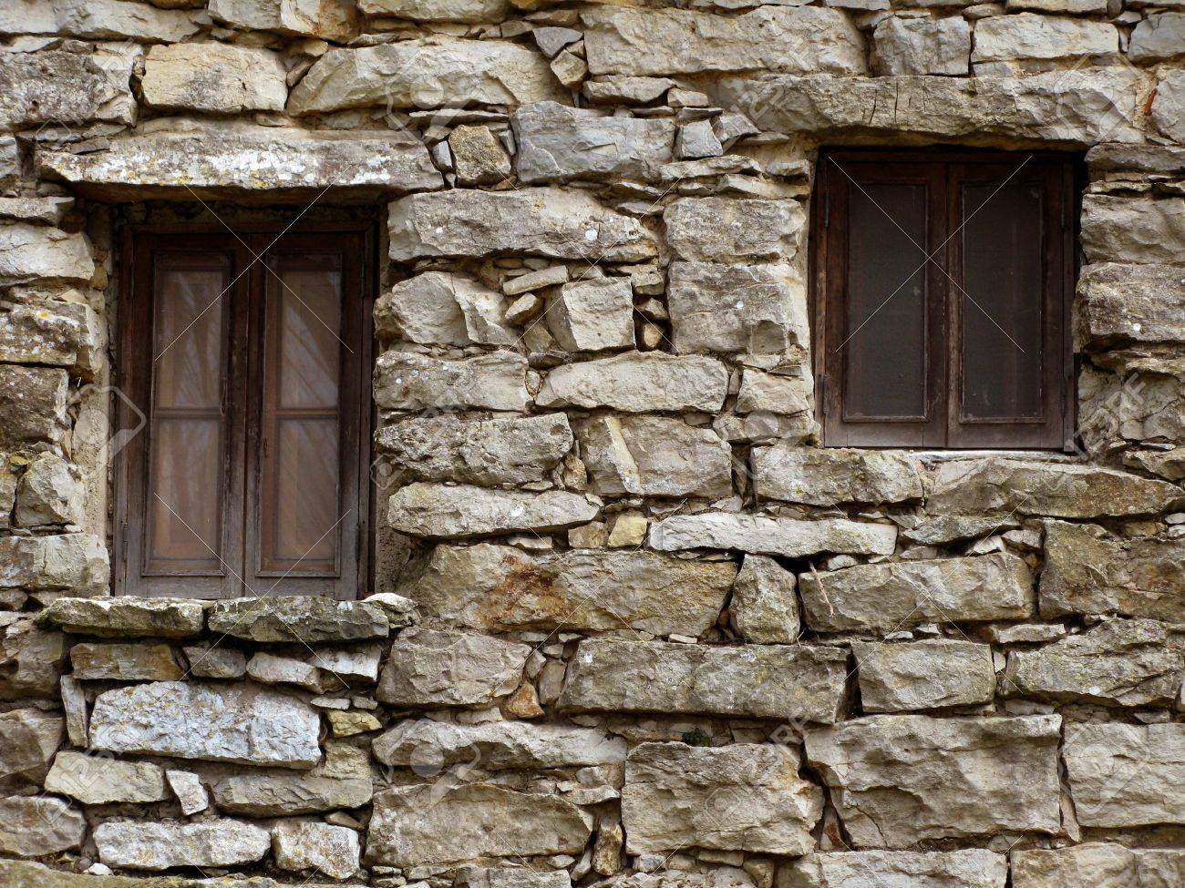 Sensational Abandoned House Stone Wall With Two Windows Stock Photo Picture Largest Home Design Picture Inspirations Pitcheantrous