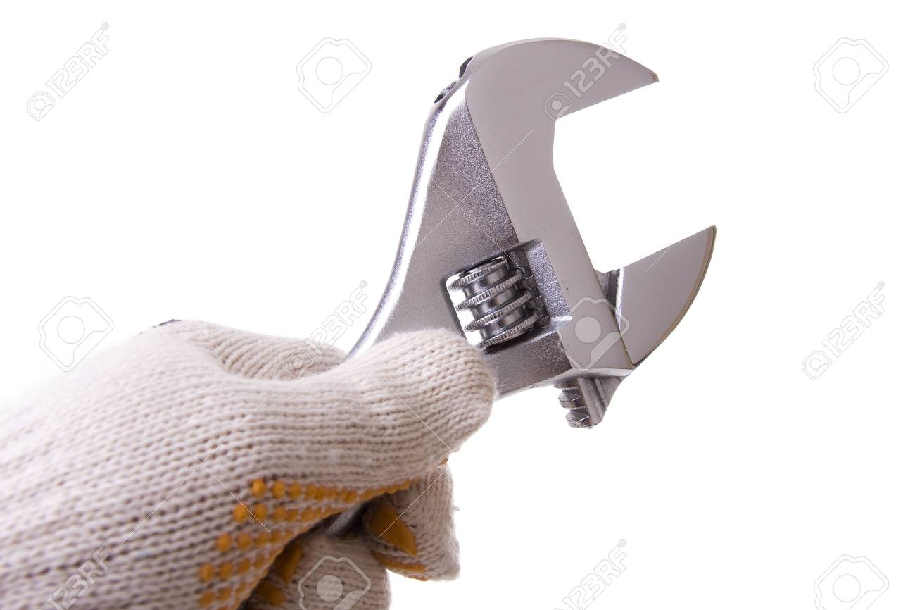Hand with a glove holding a wrench key isolated on white Stock Photo - 4664433