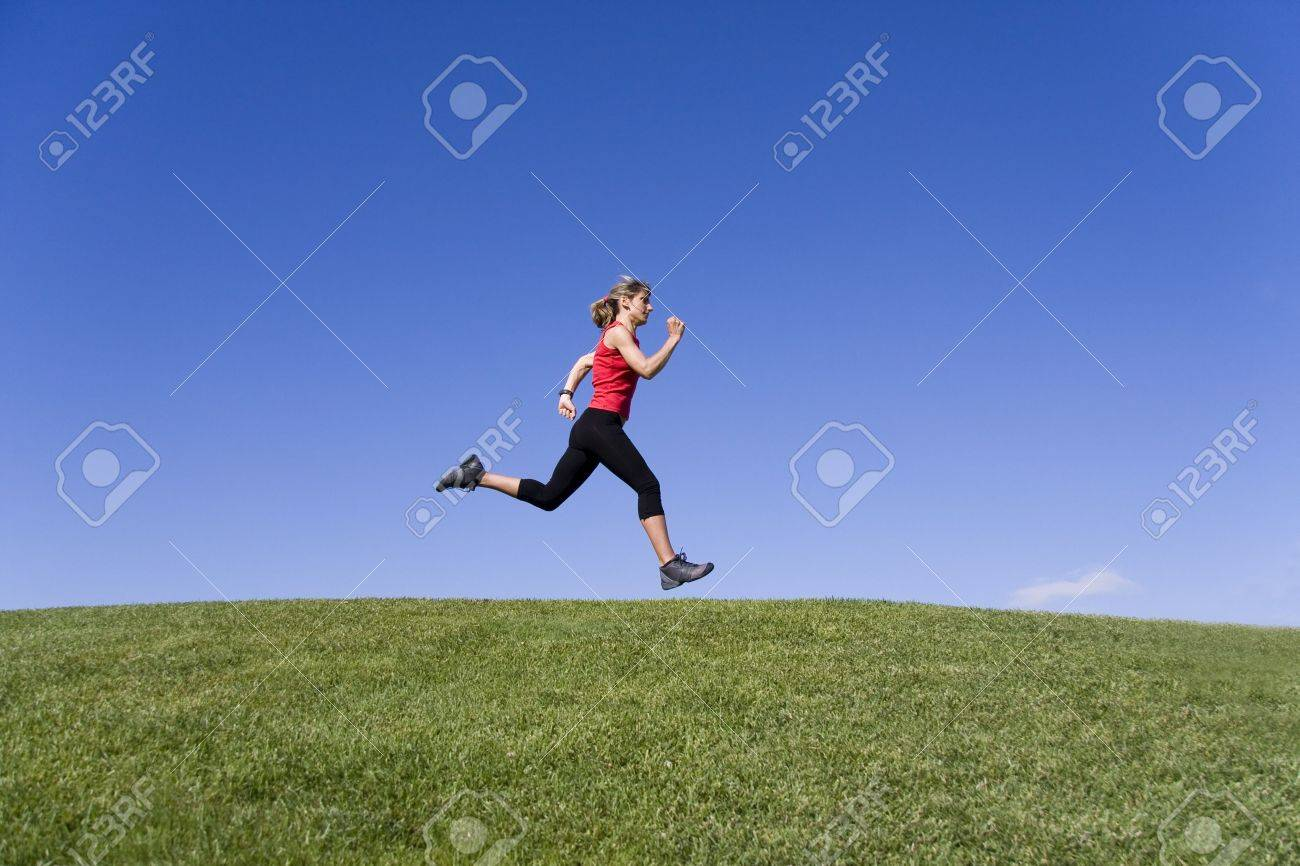 Sportive young women running on the nature Stock Photo - 6234330