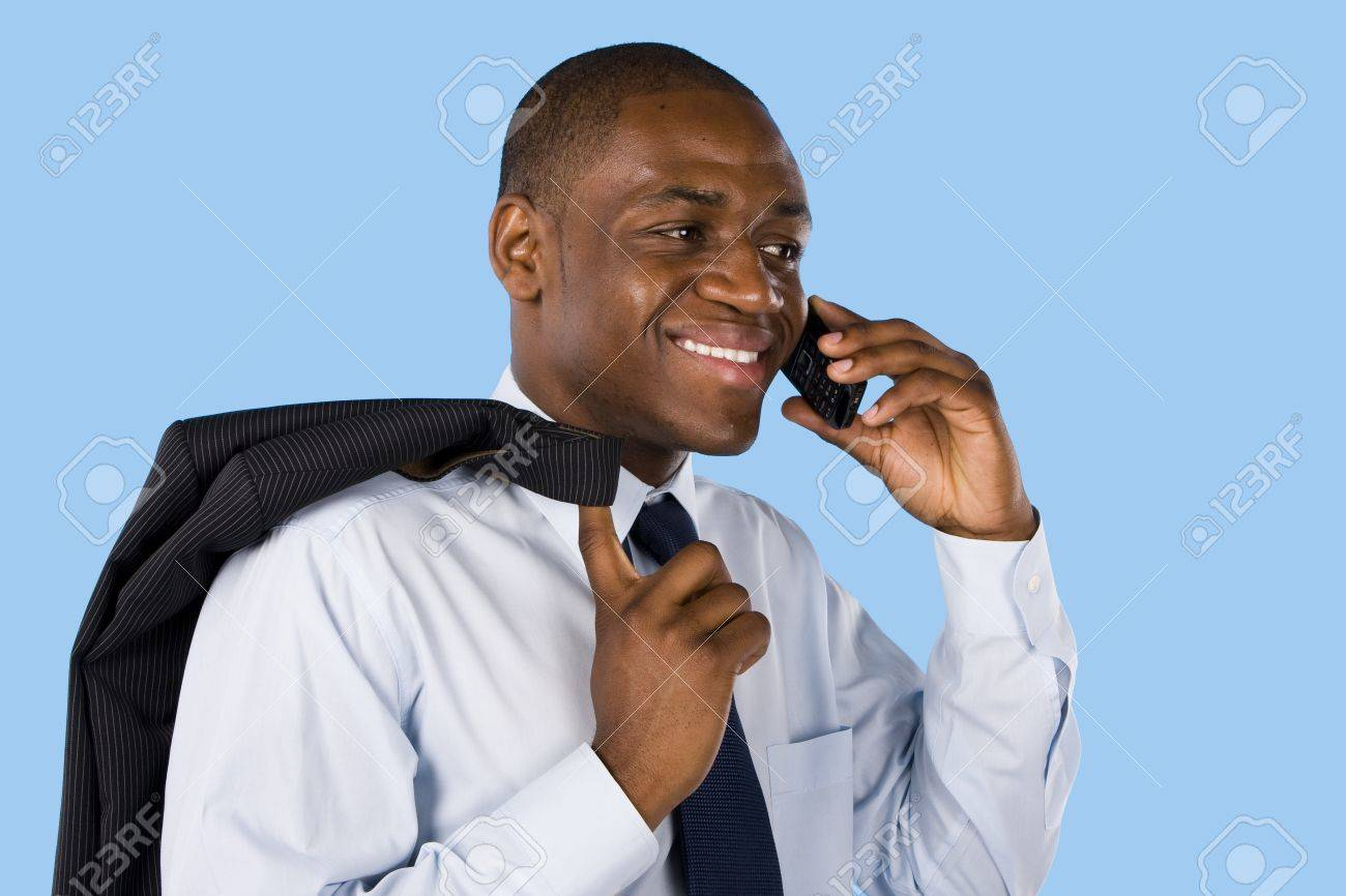 Young business man on phone isolated on blue Stock Photo - 7306857