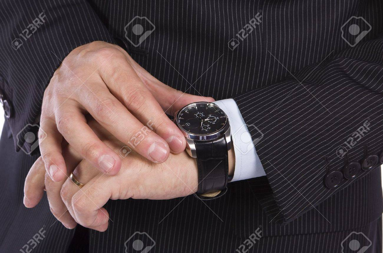 Businessman checking the time on his watch Stock Photo - 8414987