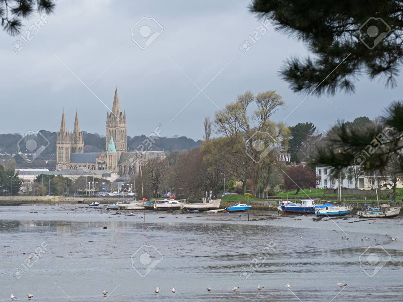 The cathedral and riverside moorings in Truro city with the river