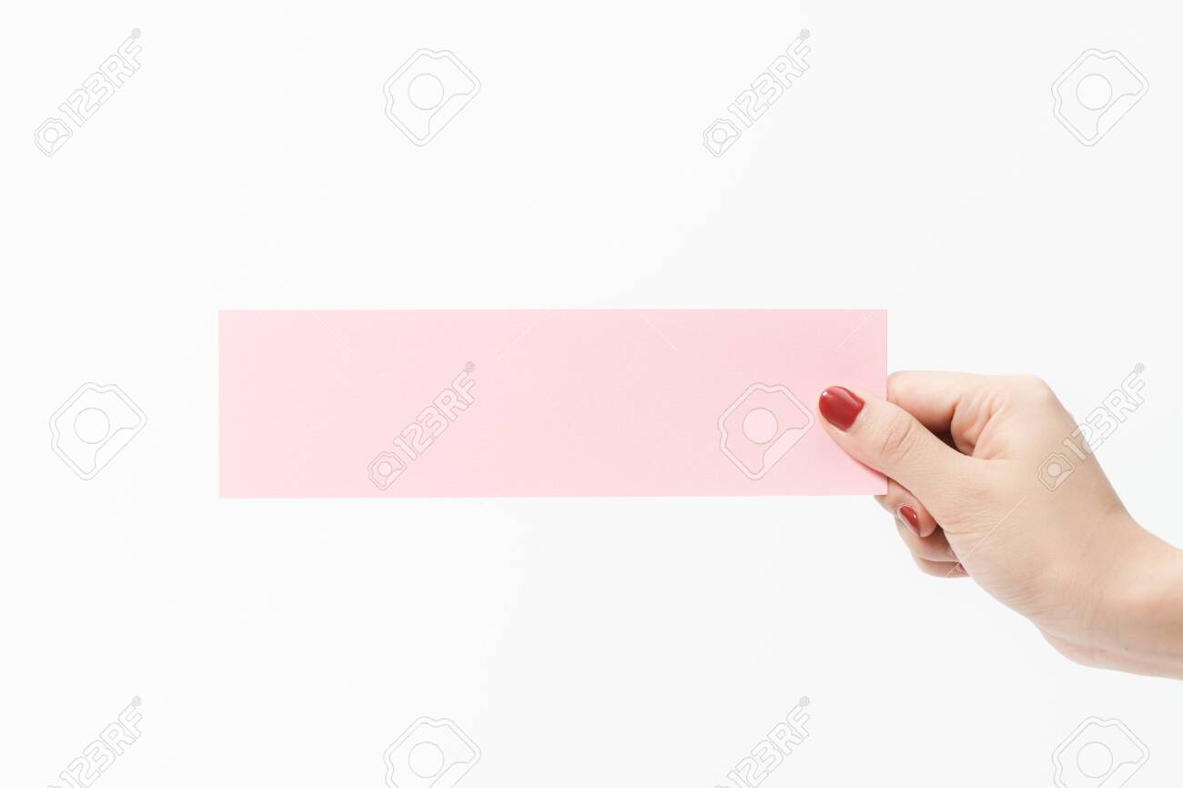 Close up women holding pink blank paper on white background. Free space, ready for type with text banner. - 137151924