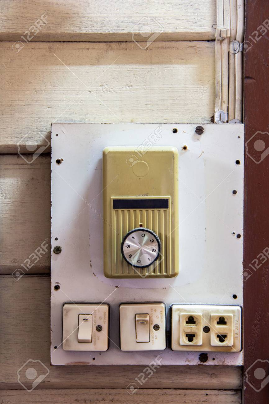 Old switch and plug of ceiling fan and neon lamp on wooden wall old switch and plug of ceiling fan and neon lamp on wooden wall stock photo aloadofball Images