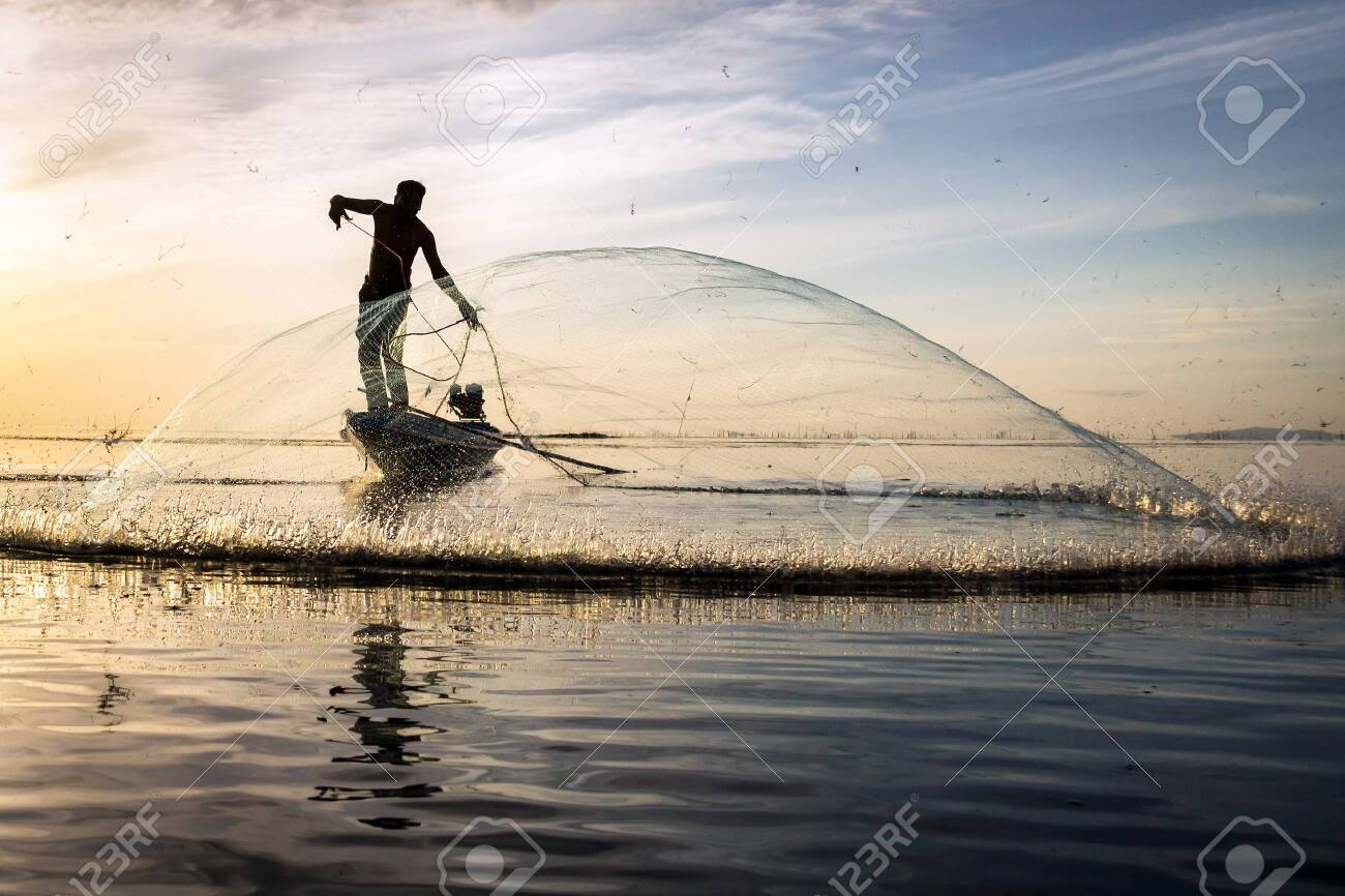 Silhouette Of Traditional Fishermen Throwing Net Fishing At Sunrise Stock Photo Picture And Royalty Free Image Image 128365638