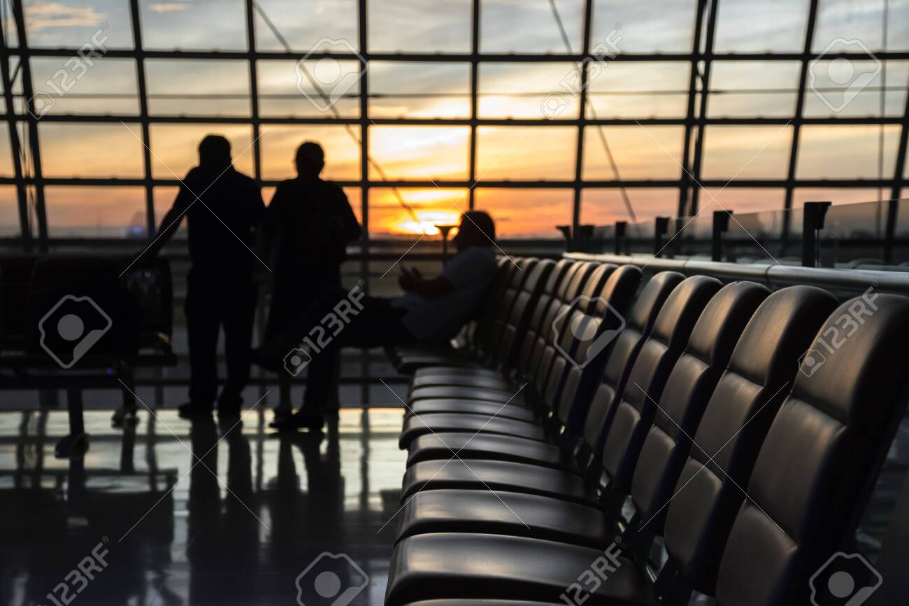 Silhouette of a airport at sunset. Seats for waiting flights at the airport. Concept of business and travel in modern lounges. - 139644924