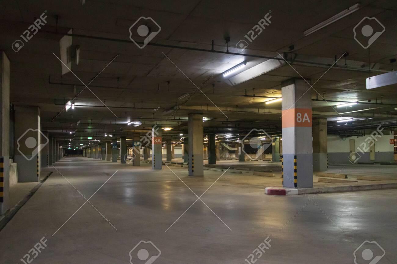 Empty parking interior at night. Parking garage at eight floor. - 142137267