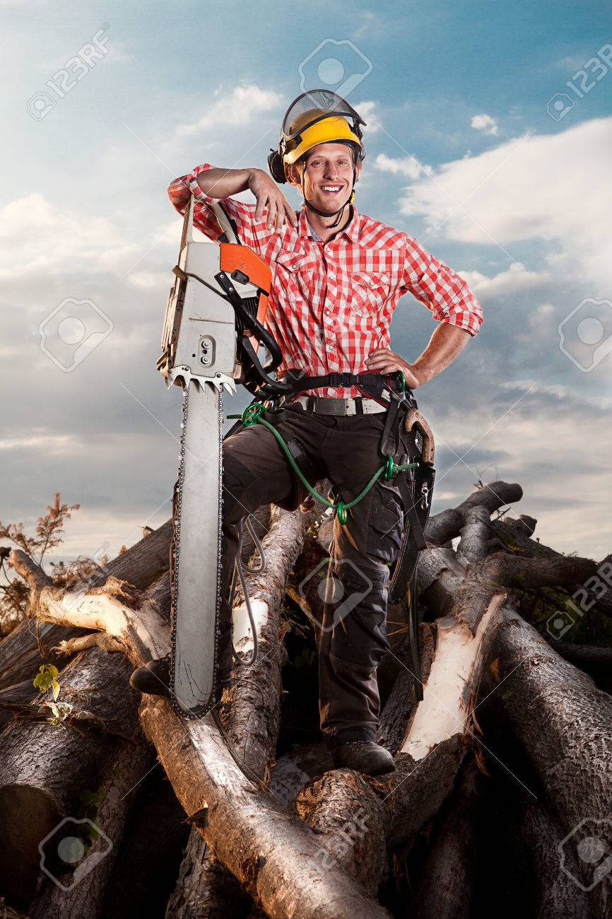 smiling lumberjack with chainsaw - 23694438