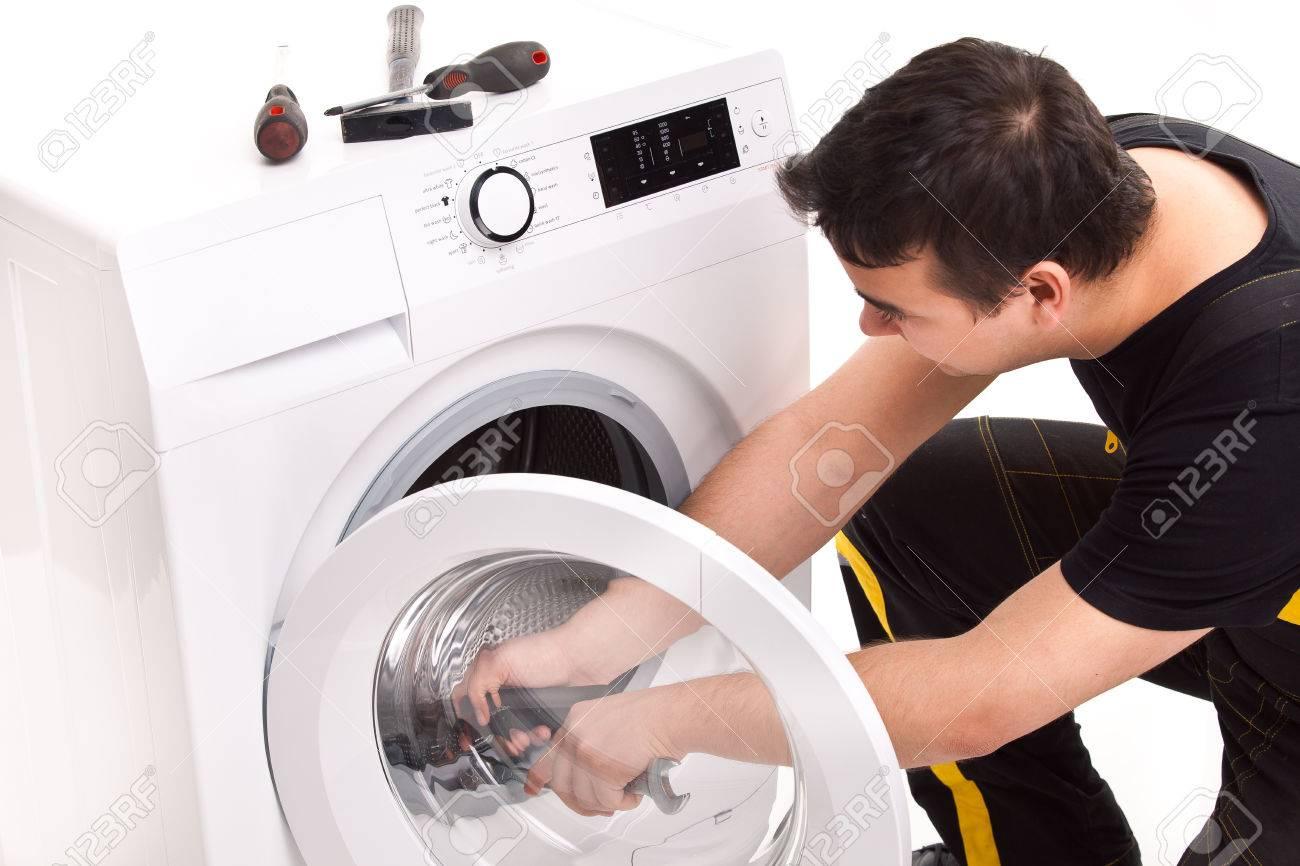 studio photo of washing machine repairman - 23735090