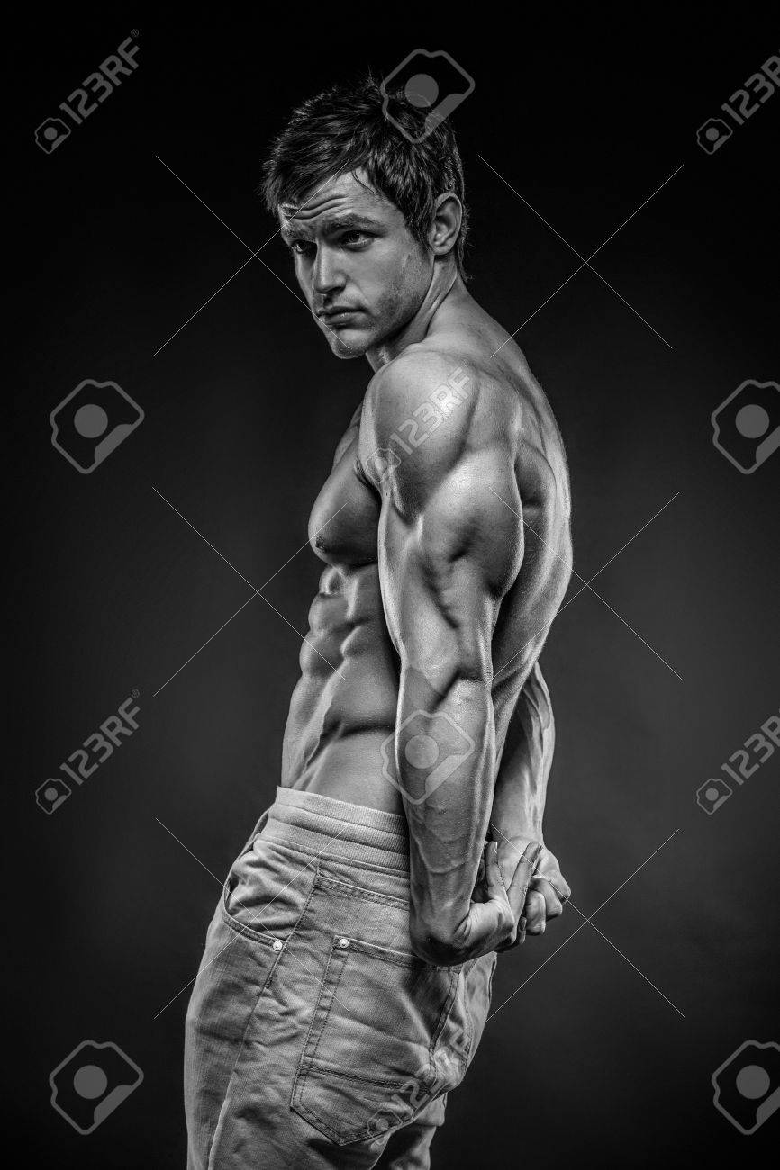 Strong Athletic Man Fitness Model posing back muscles, triceps, latissimus - 29565577