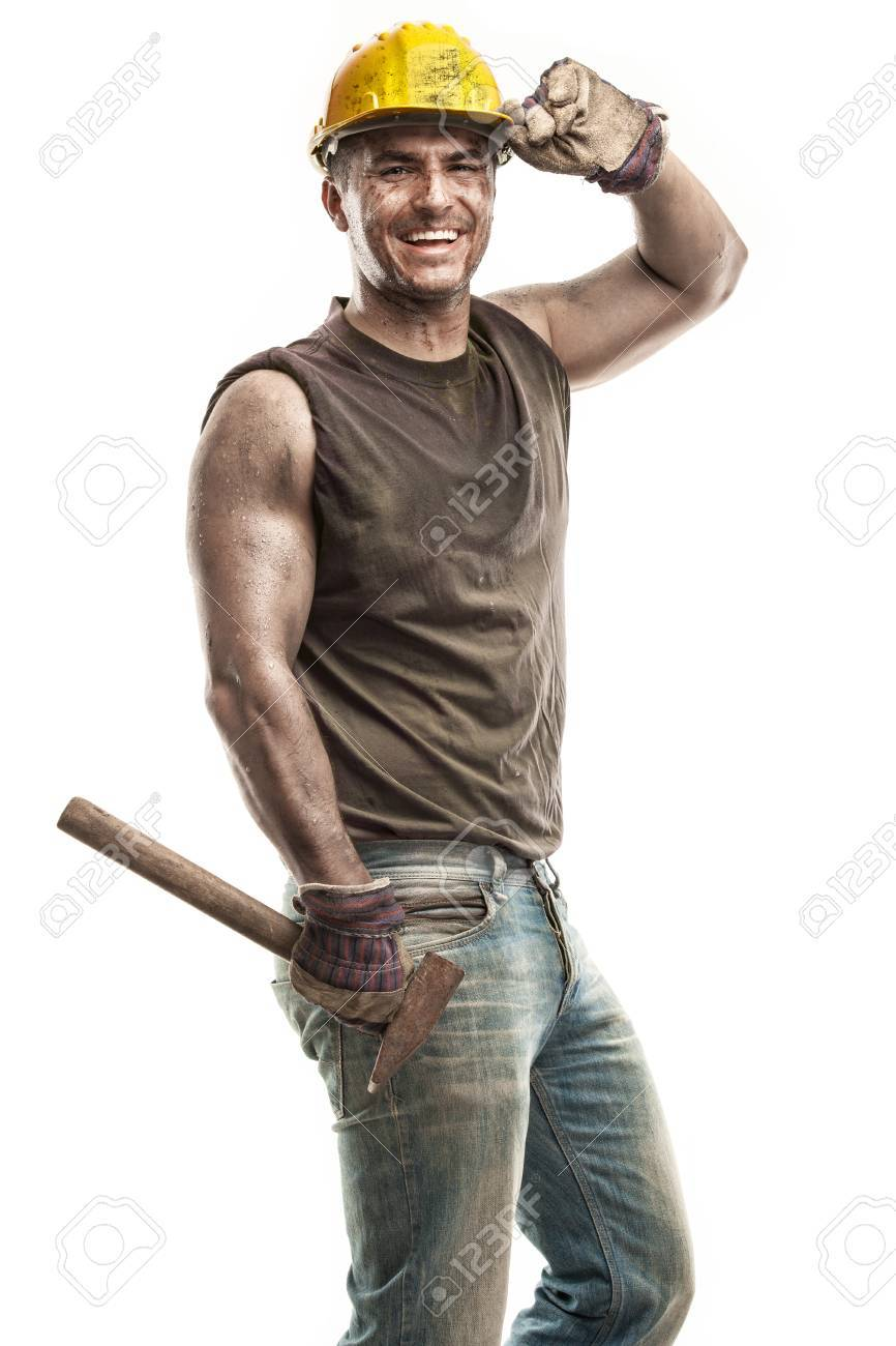 Young dirty Worker Man With Hard Hat helmet holding a hammer and smiling isolated on White Background - 29565759