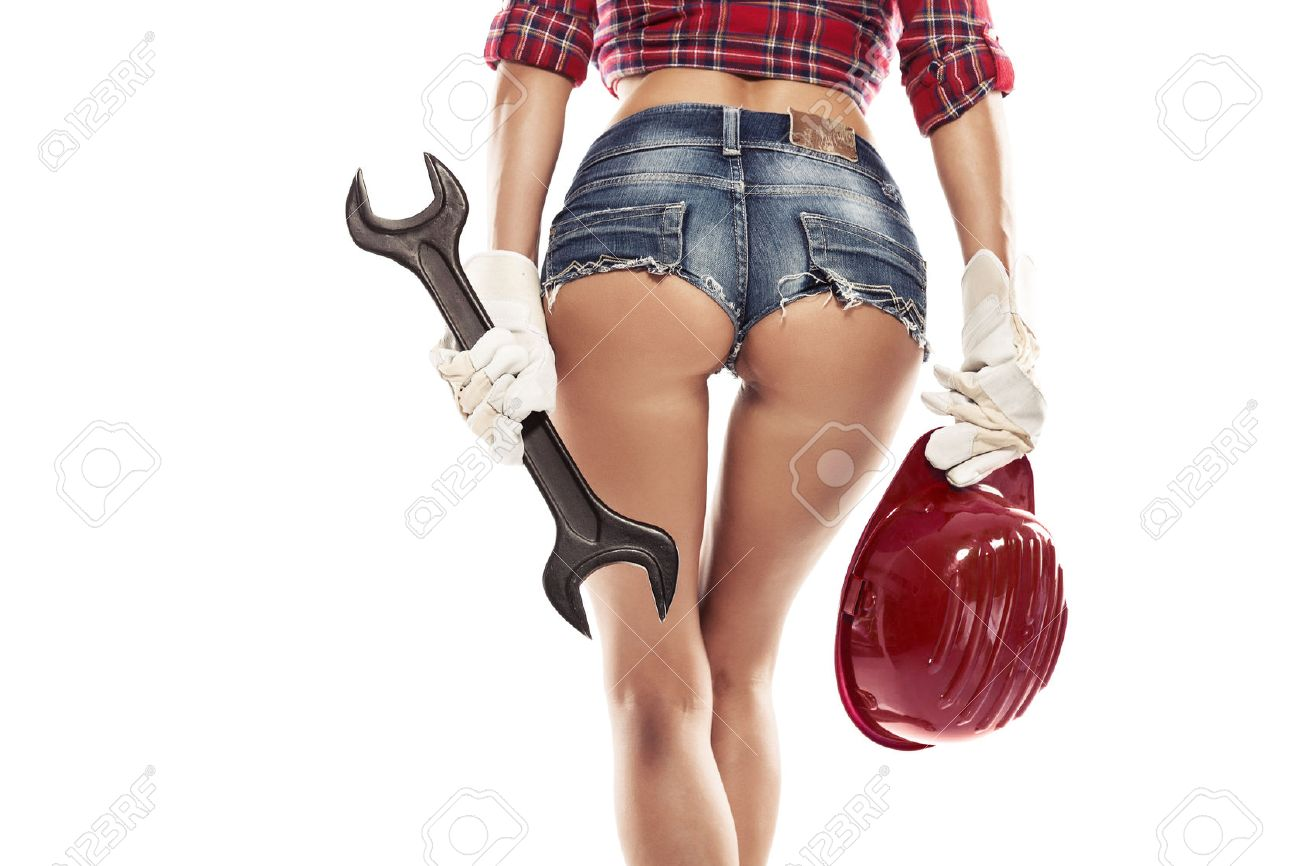 Nice woman mechanic showing bum buttock and holding wrench isolated over white background - 38603598