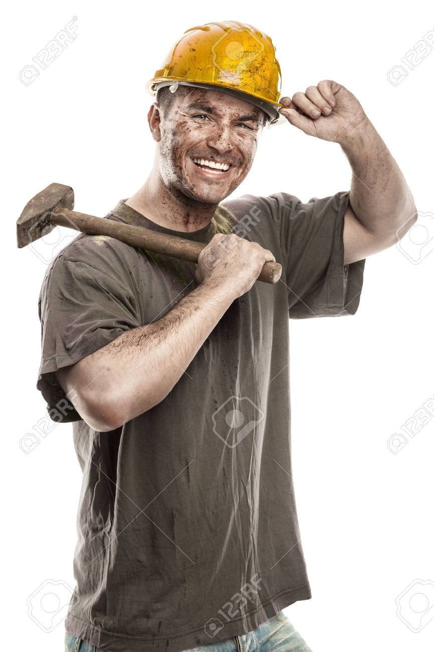 Young dirty Worker Man With Hard Hat helmet holding a hammer isolated on White Background - 38539126