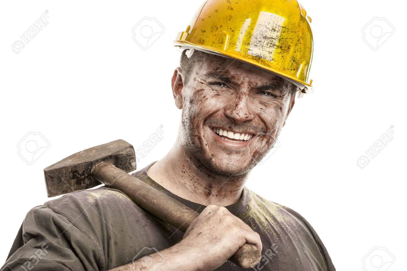 Young dirty Worker Man With Hard Hat helmet holding a hammer isolated on White Background - 38539131