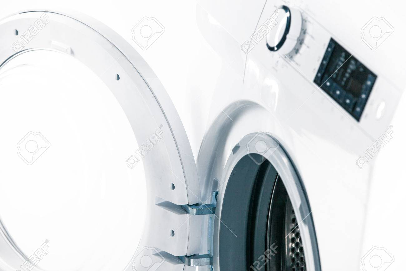 Washing machine with an open door detail on white background - 38543293