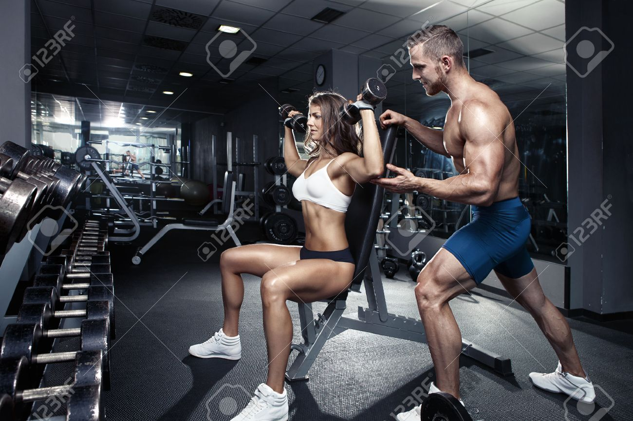 beautiful young sporty sexy couple workout in gym Stock Photo - 41521333