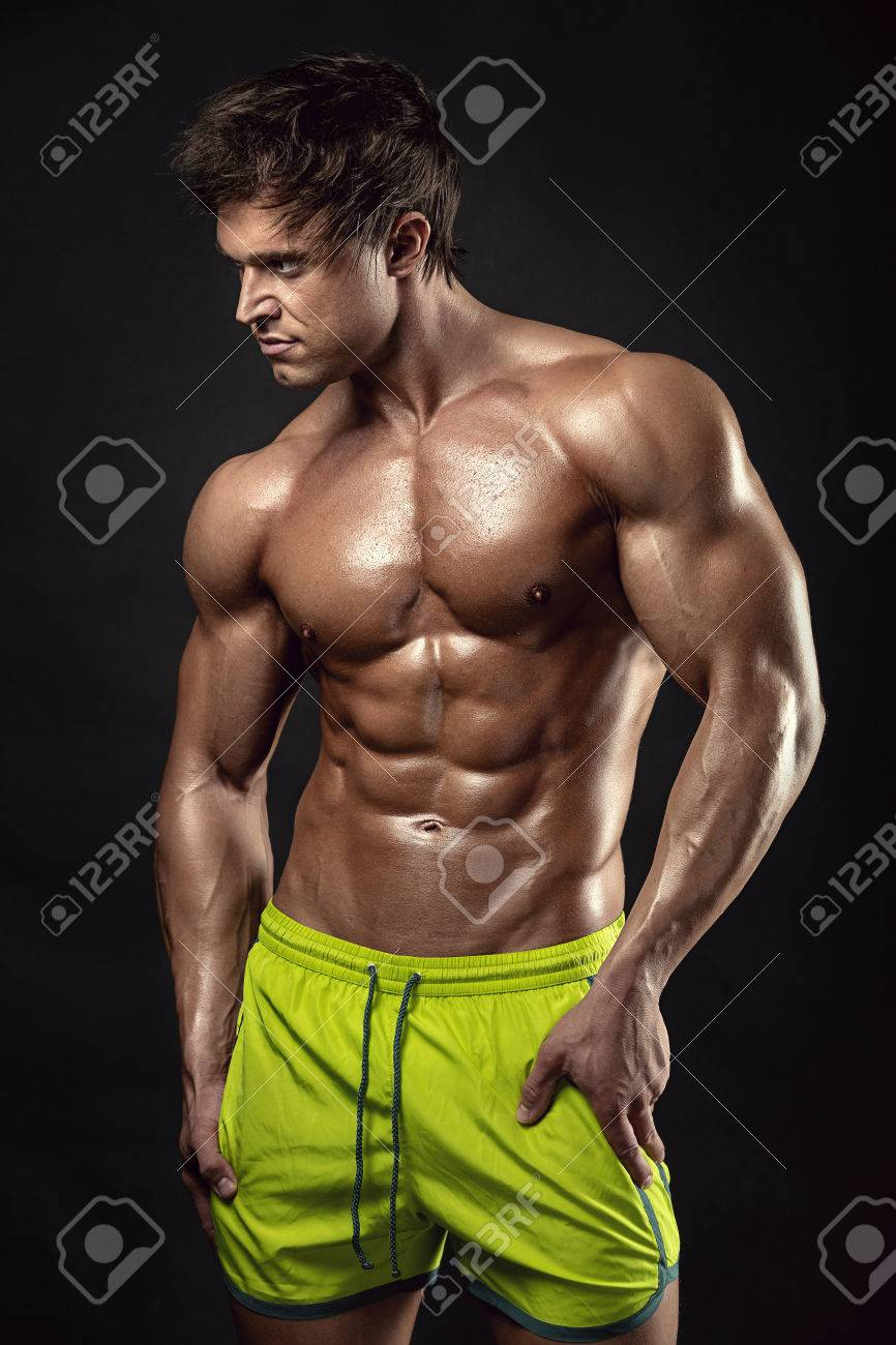 Strong Athletic Man Fitness Model Torso showing big muscles over black background - 53597512