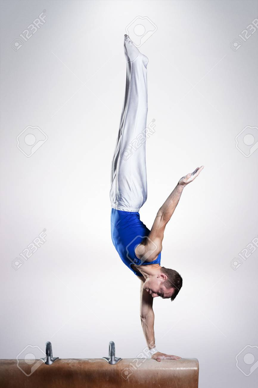 portrait of young man gymnasts competing in the stadium - 81110801