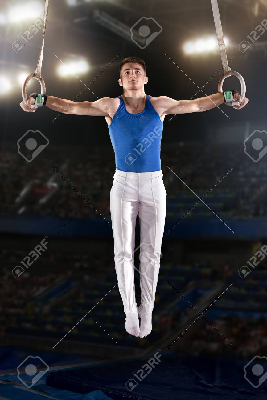 portrait of young man gymnasts competing in the stadium - 80731001