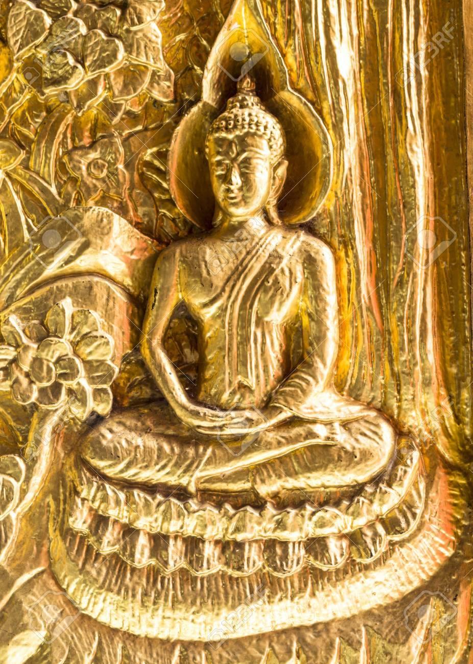 Golden Buddha (statue) on the door in Wat phra Taen Sila Art, Uttaradit, Thailand. - 17039814