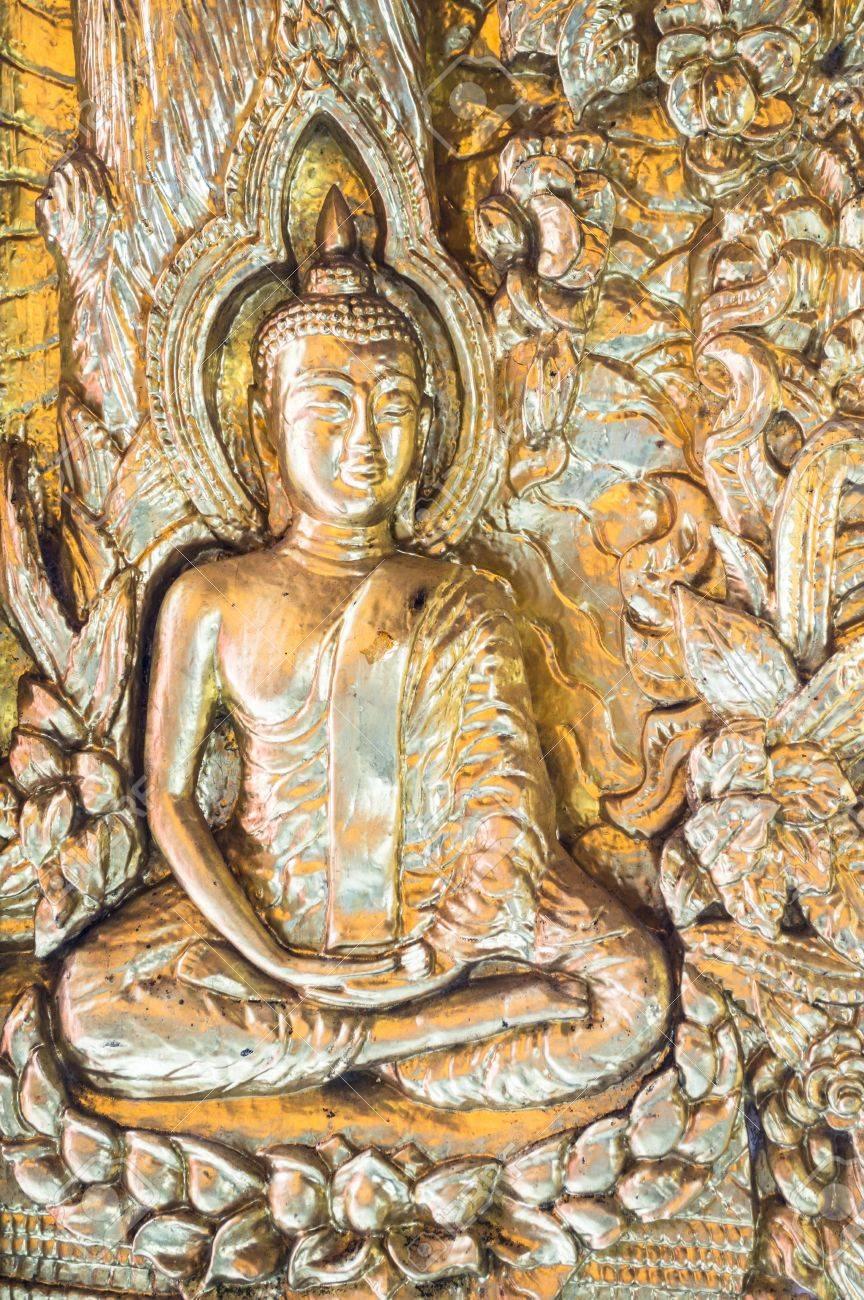 Metal buddha on the door in Wat phra Taen Sila Art, Uttaradit, Thailand. - 17046104