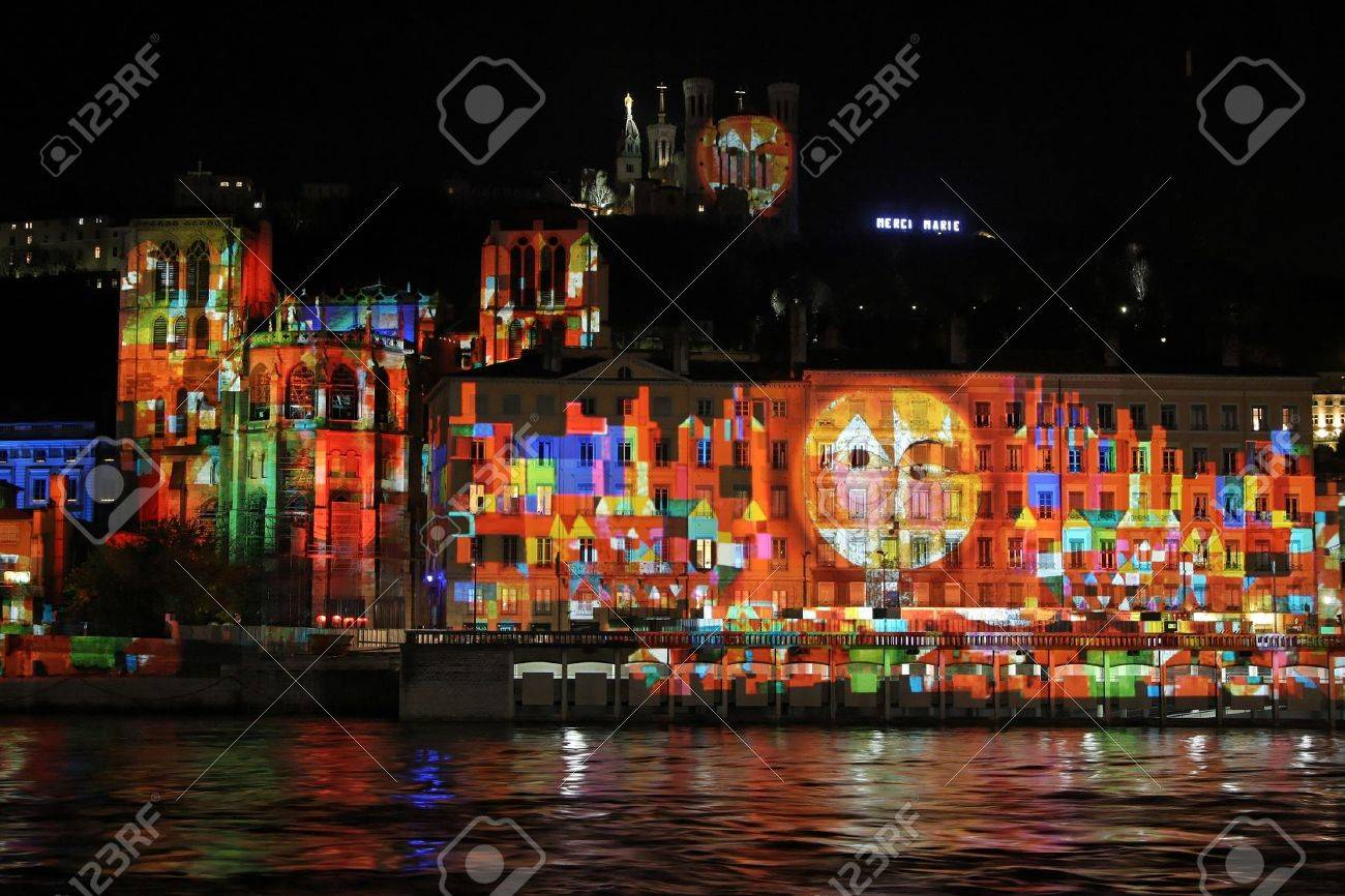 LYON, FRANCE - DECEMBER 6 : Festival of Lights in the streets of Lyon on December 6, 2012 in Lyon, France. The Festival of Lights expresses gratitude toward Mary, mother of Jesus around December 8 of each year - 16817165