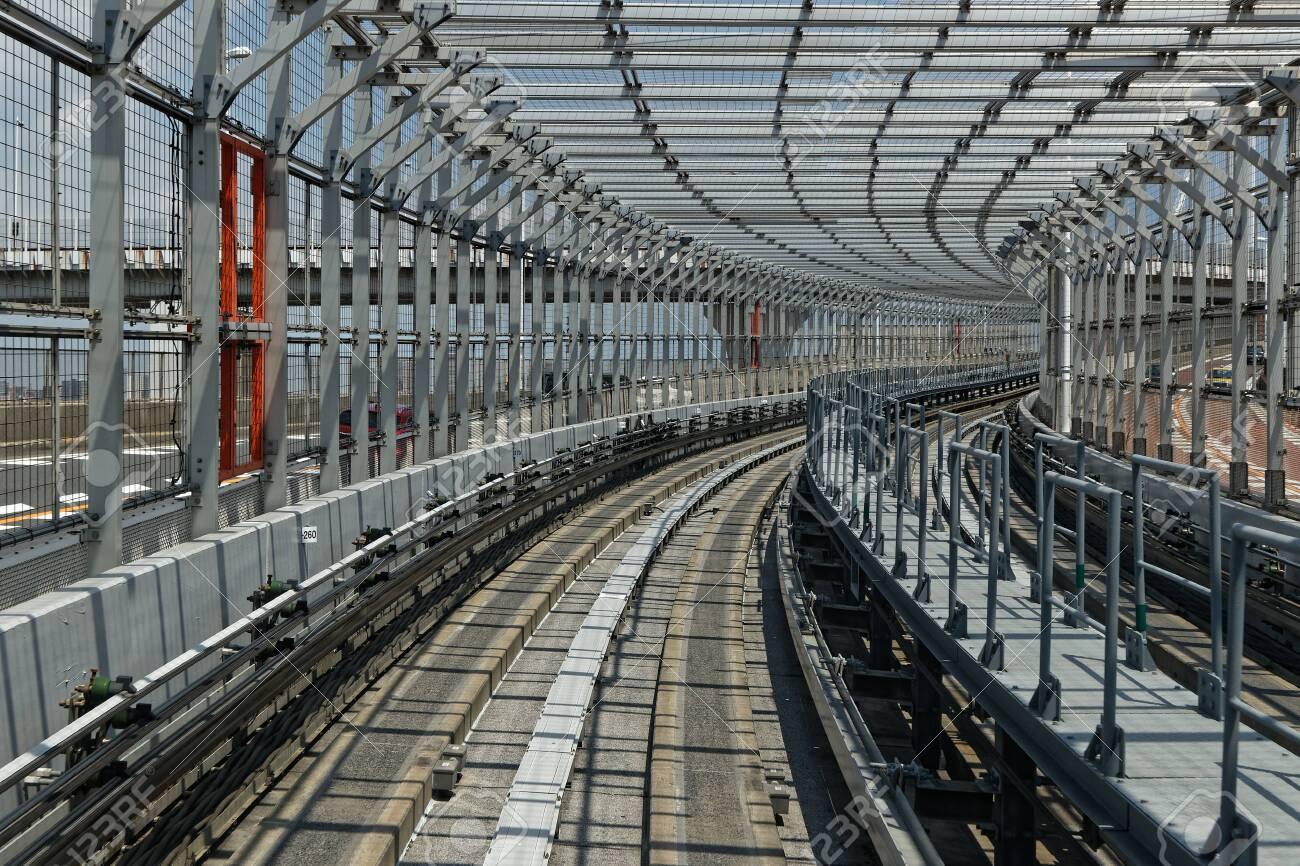 Monorail railways on Rainbow Bridge, Odaiba, Tokyo - 125390639