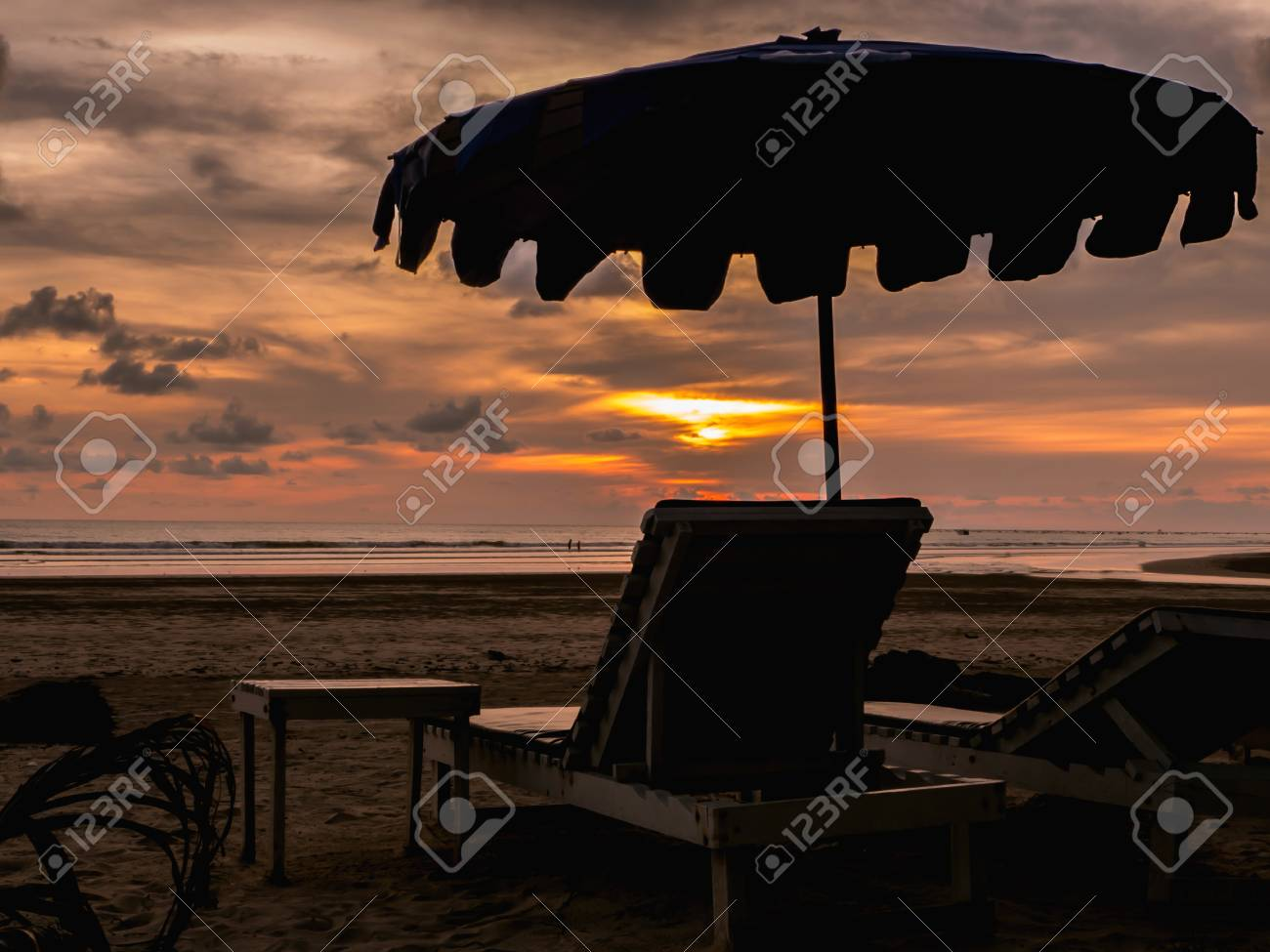 Silhouette Beach Chairs With Umbrella At Sunset Stock Photo Picture