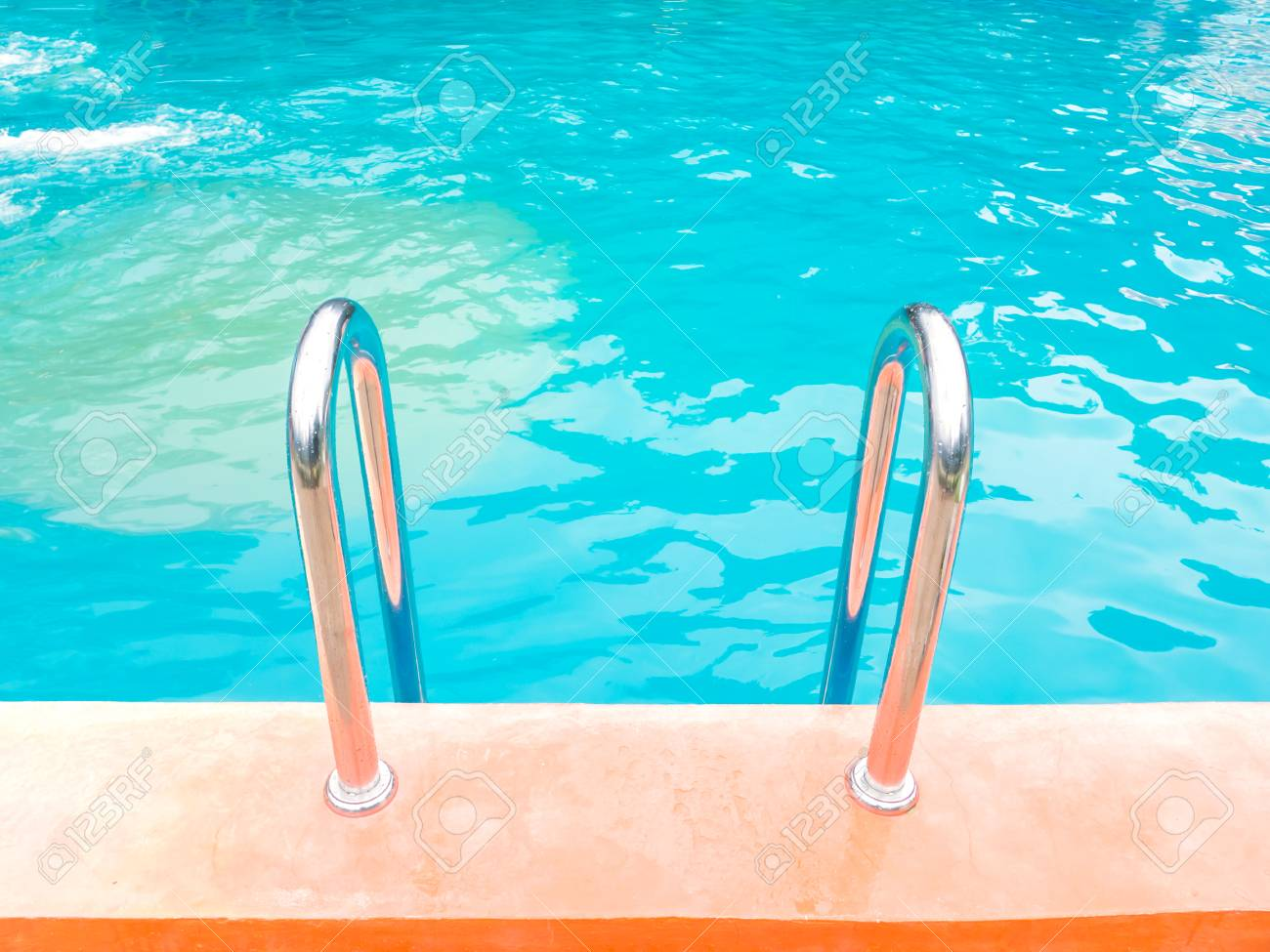 swimming pool with orange cement edge and stair.