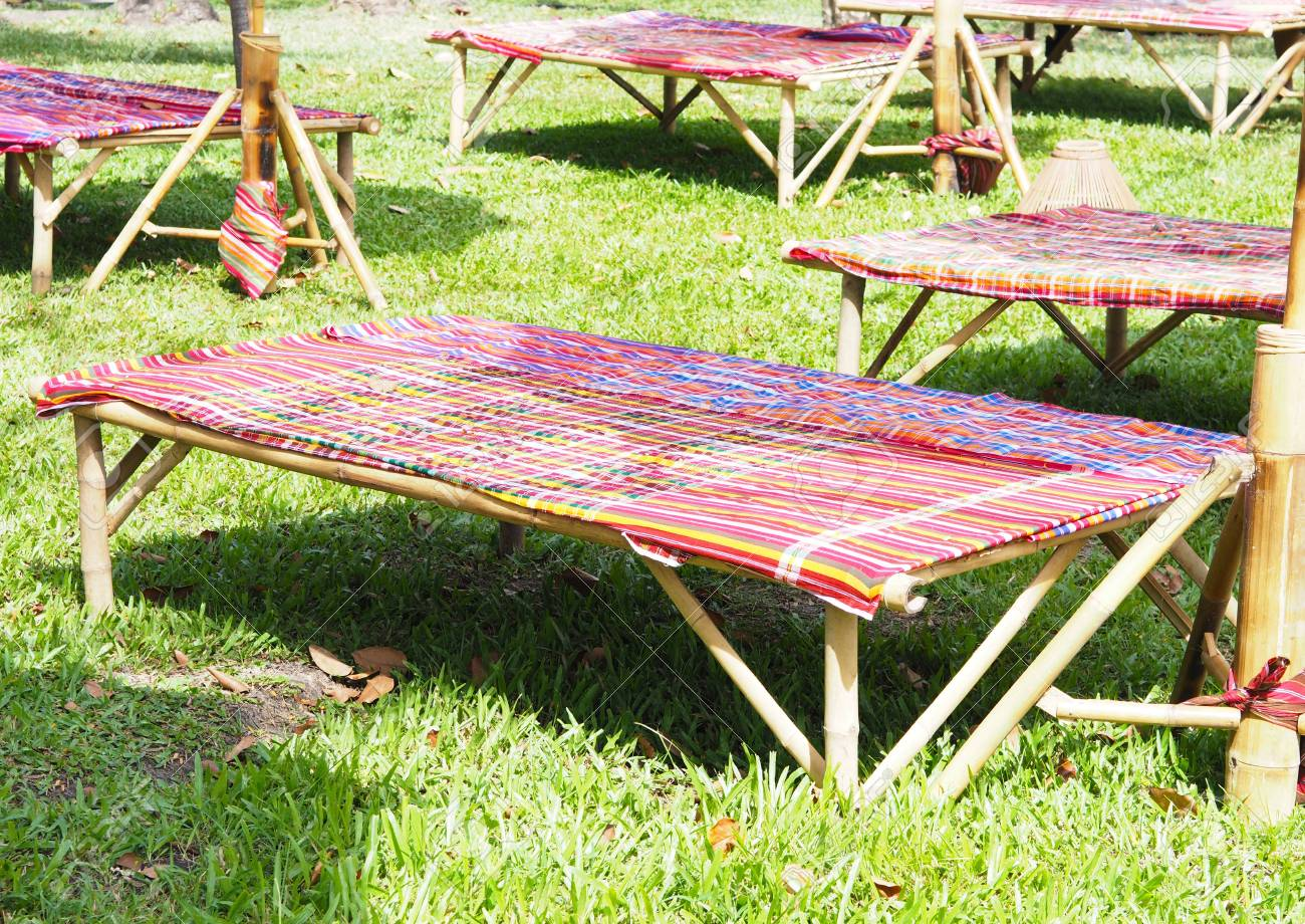 Colorful Long Bamboo Benches With Local Thai Fabric At Public Summer Park  In Thailand. Party