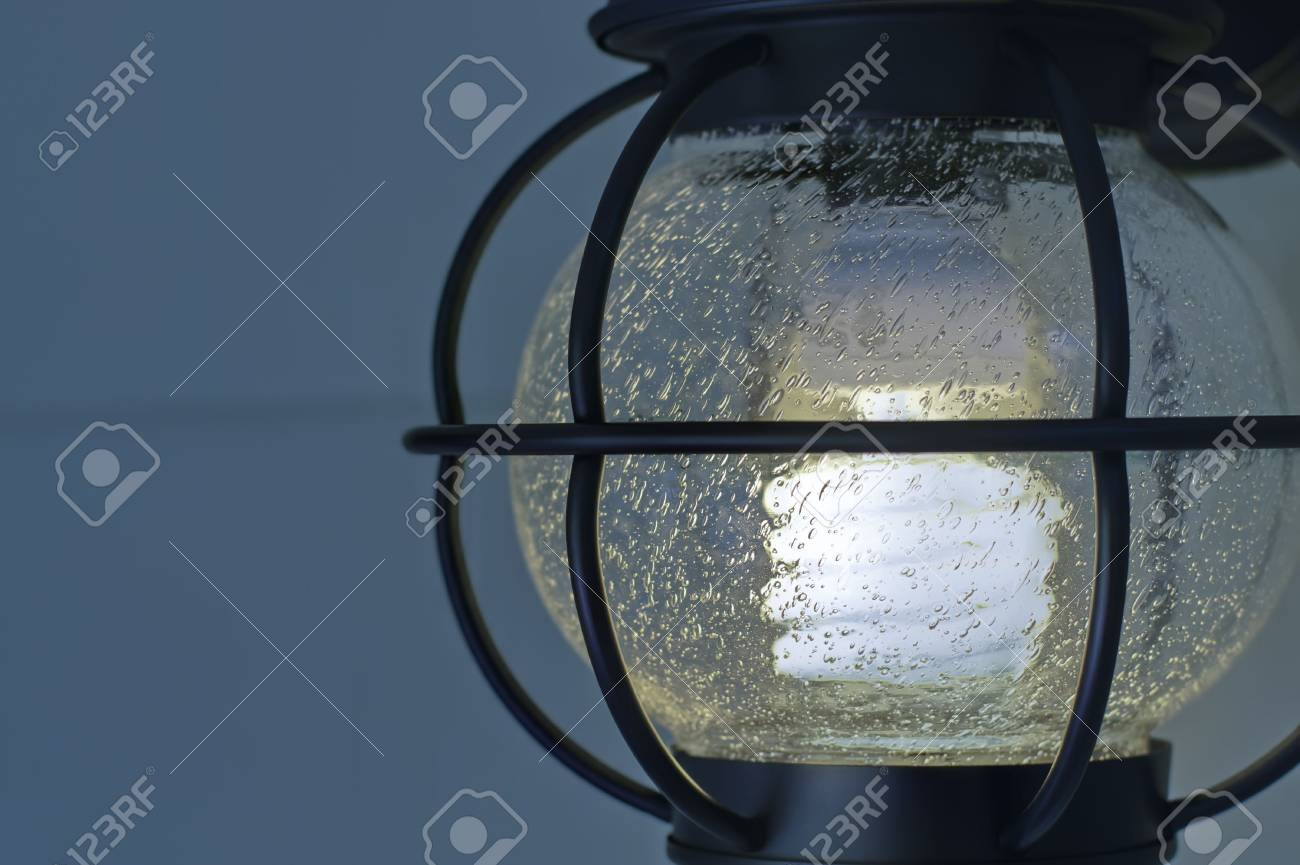 Single exterior compact fluorescent electric light fixture. Stock Photo - 3033218