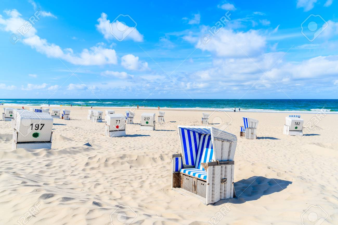 Chairs on white sand beach in Kampen village, Sylt island, Germany - 92565014