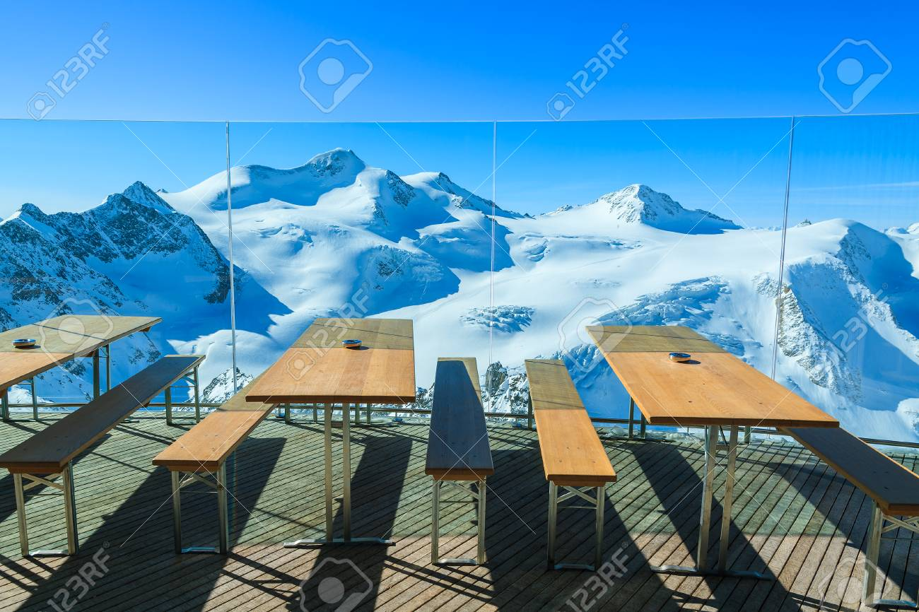 restaurant tables with view of mountains in winter season, pitztal