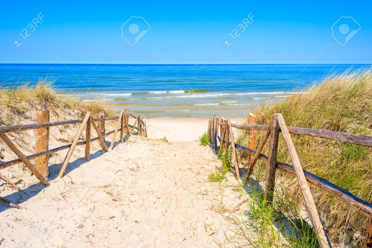 Entrance to sandy beach on coast of Baltic Sea near Lubiatowo village, Poland - 92932650