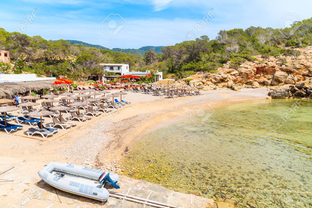CALA CARBO, IBIZA ISLAND - MAY 19, 2017: dinghy boat and restaurants