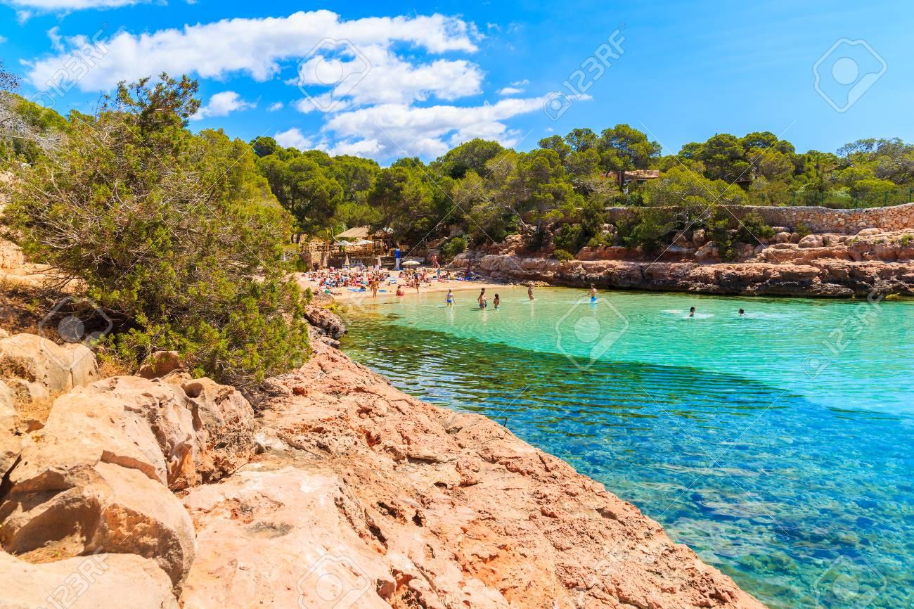View Of Beautiful Cala Gracioneta Beach With People Swimming Stock