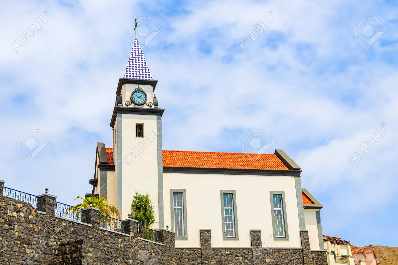 Church Building Against Blue Sky With White Clouds On Coast Of