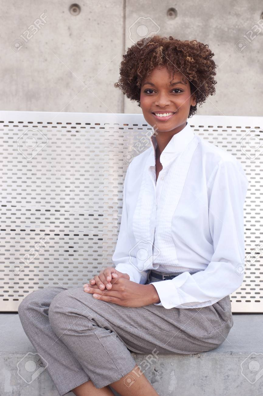 pretty African American executive sitting outside Stock Photo - 13138352