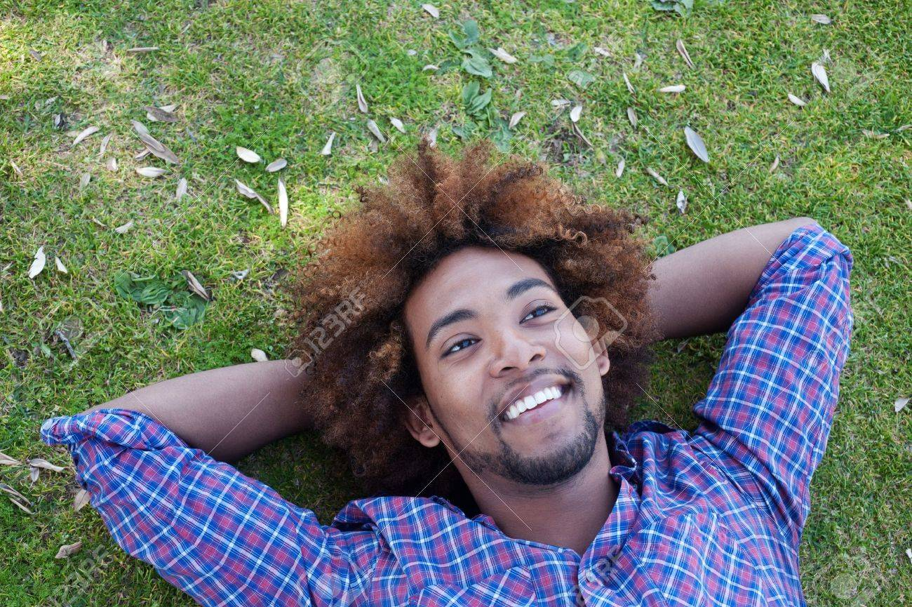young, happy african american male lying in grass Stock Photo - 13446150