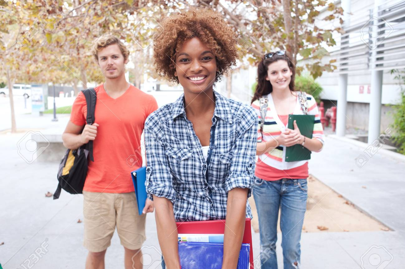 Happy group of students holding notebooks outdoors Stock Photo - 15413489